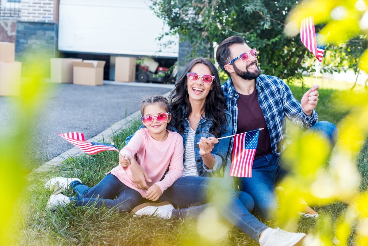 Video Gifts for Veterans and Active Duty Military Members, Reasons to Create a Video for an Active Duty Military Member, Family Moving Boxes and Flags