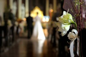 Wedding Video Guide—7 Types of Videos for Weddings, Distant Image of Blurred Wedding Alter and Flowers